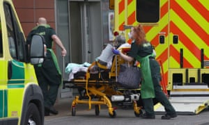 A patient is brought into the Royal London Hospital, part of Barts Health NHS trust on Sunday 10 January.