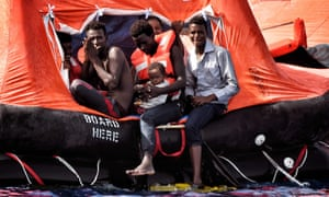 People await rescue in a drifting boat in the Mediterranean last year