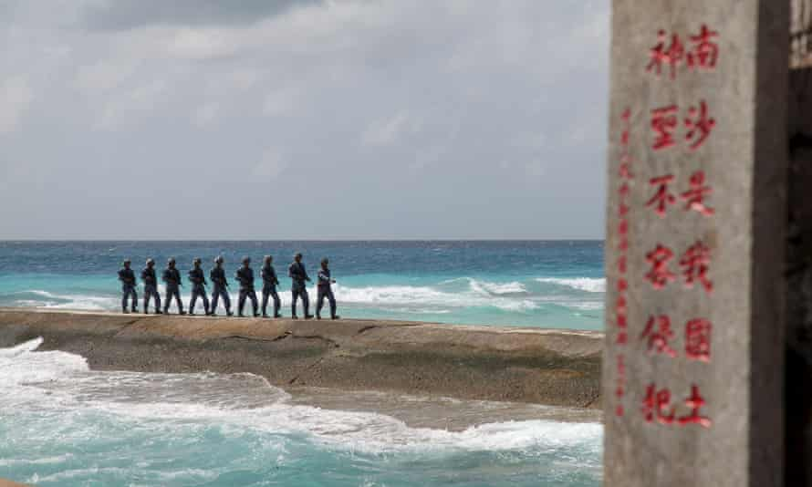 Soldiers of China's People's Liberation Army (PLA) Navy patrol in the Spratly Islands.