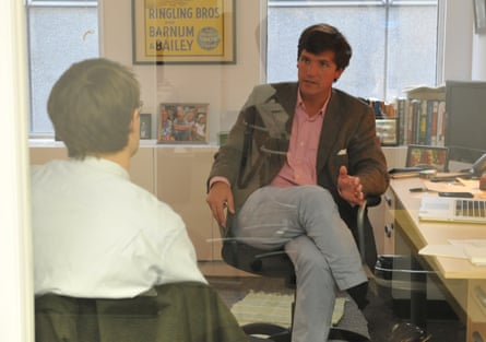"Tucker Carlson, R, talks with Jon Ward at the office of the new conservative website, the Daily Caller, on January 6, 2010, in Washington, DC. The site, at which Carlson is the editor-in-chief and Ward is a reporter, has been branded as a ""conservative Huffington Post."""