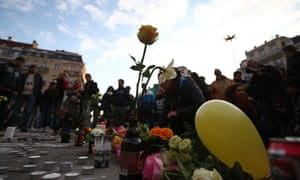 People gather to leave tributes at the Place de la Bourse following  attacks in Brussels, Belgium