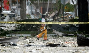 A firefighter walks through the remains of a building after an explosion in Plantation, Florida, on 6 July.