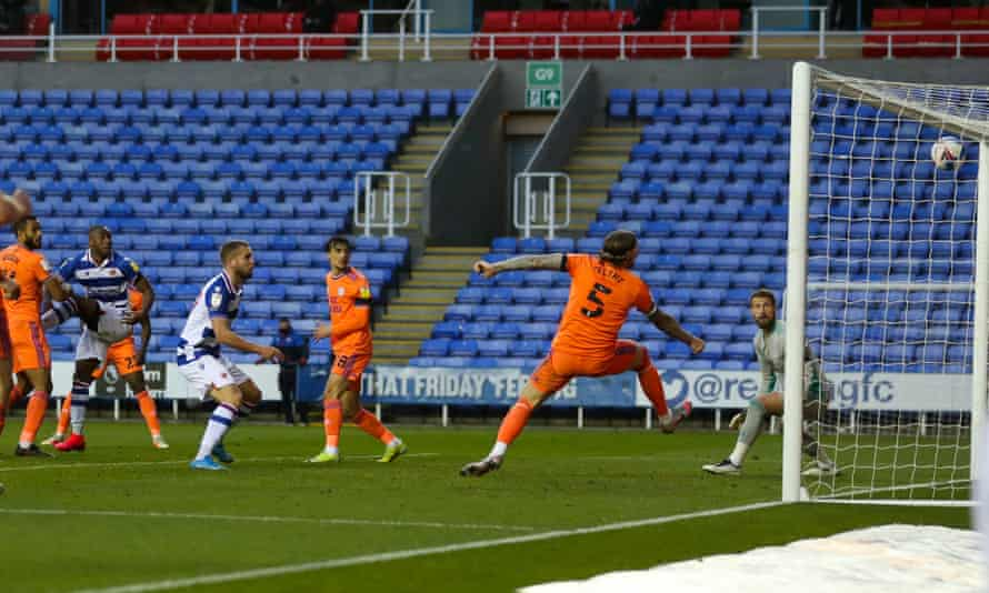 Yakou Méïté heads in Reading's stoppage-time equaliser against Cardiff.