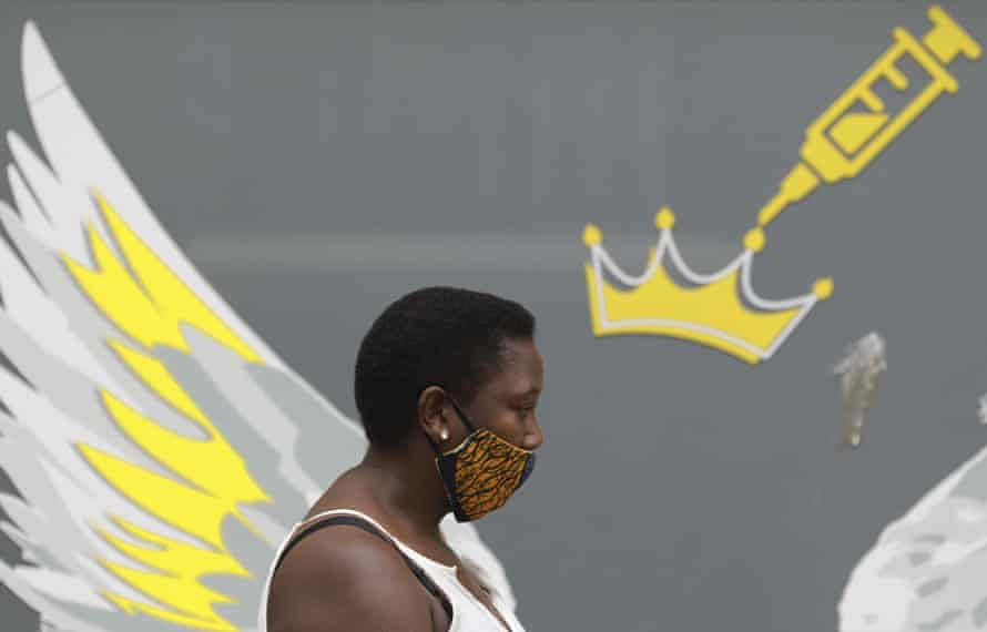 A woman wears a mask to protect against coronavirus, Cape Town, South Africa