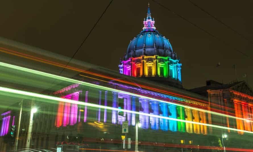 San Francisco City Hall lit with rainbow lights for Pride, USA.