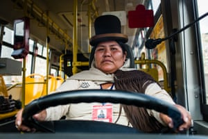 La Paz bus driver Sara Quispe Mamani, 33, on the wheel of the bus that she drives daily through the streets of La Paz. Sara is the second cholita to ever drive a bus in La Paz. At first she started to drive small vans with passengers as a way to make money to feed her children after she separated from her partner. Then she went to drive bigger buses. She loves it so much that her dream now is to become an international truck driver