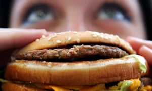 Person eating fast food burger