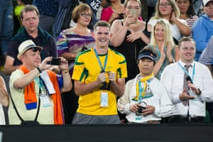 A fan who caught Roger Federer's bandana.