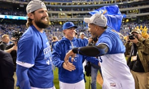 Royals       manager Ned Yost (middle) and catcher Salvador Perez (right)       celebrate after defeating the Blue Jays.