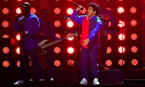 Bruno Mars, right, performs at the Brit awards.