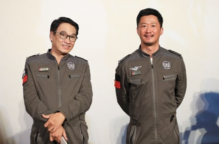 Actor Ng Man-tat and actor Wu Jing attend a press conference of film 'The Wandering Earth' in Beijing.