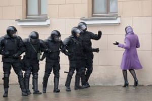A woman argues with Belarus police officers blocking a street during an opposition rally in Minsk, Belarus, on 25 March, 2017