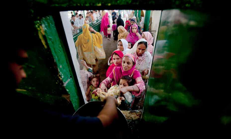 A Pakistani woman receives free food