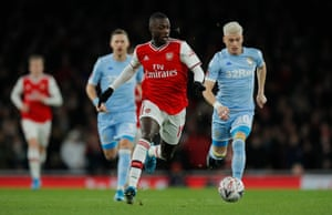 Arsenal's Nicolas Pepe goes past Leeds United's Ezgjan Alioski.