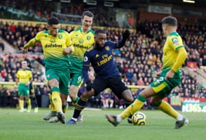 Lacazette, covered by the Norwich defence.
