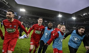 Andrezieux players celebrate after winning the tie at the Geoffroy Guichard stadium in Saint-Etienne.