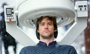 Jim Carrey staring straight ahead, the top of his head in a machine, in The Eternal Sunshine of the Spotless Mind