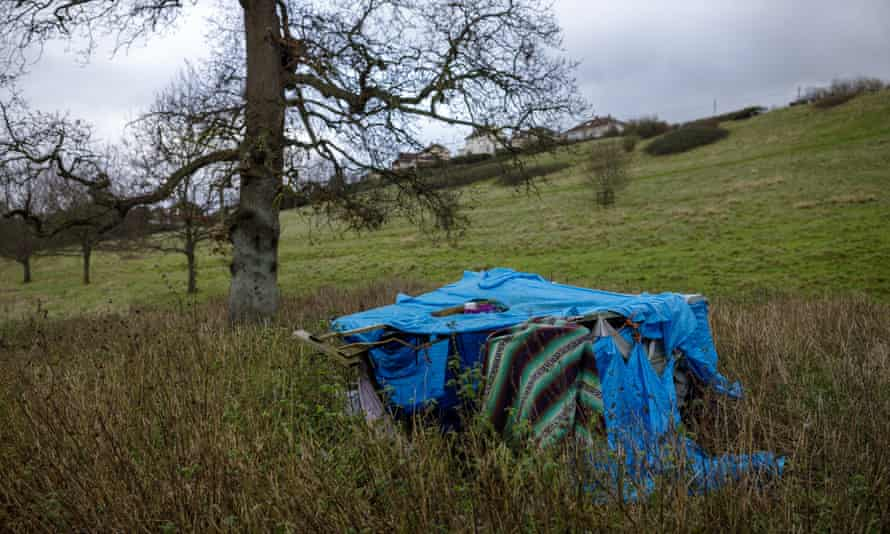 Abandoned camping equipment in a field near Glastonbury, Somerset.