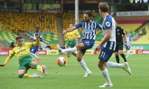 Brighton's Davy Propper's shot is blocked by Norwich's Max Aarons.