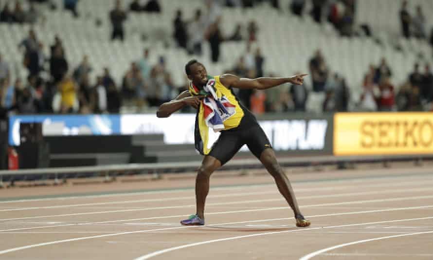 Usain Bolt strikes his trademark lightening pose at the London Stadium.