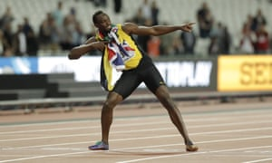 Jamaica's Usain Bolt does his trademark lightening bolt pose after the race.
