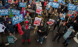 Protesters march in London against the NHS financial crisis last February.