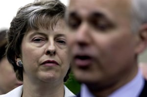 May, the first female chair of the Conservatives, appears with Iain Duncan Smith outside the party's central office in Westminster in 2002