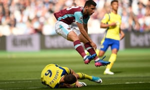 West Ham United's Jonathan Calleri leaps over Everton's Phil Jagielka.