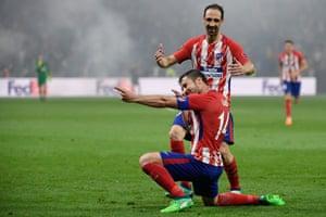 Atletico Madrid's midfielder Gabi celebrates past Atletico Madrid's Diego Godin after scoring