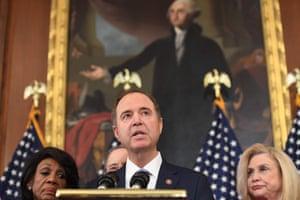 Adam Schiff speaks, in front of a portrait of George Washington.