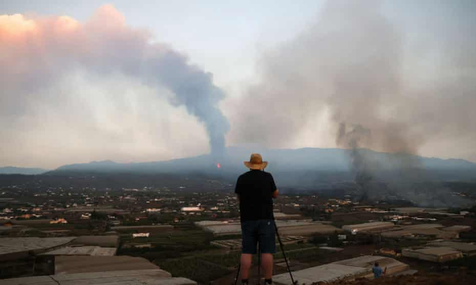 A man surveys the scene in the aftermath of the eruption on La Palma