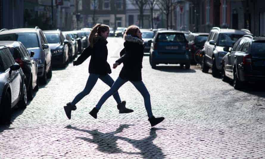Two children cross a road in Dusseldorf