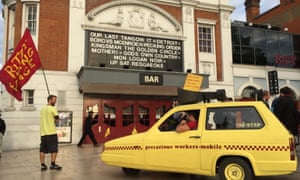 East Dulwich Picturehouse workers march through the streets of Brixton, London, and past the Ritzy cinema