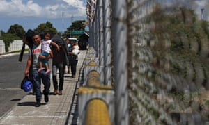 Migrants at the Mexico-Guatemala border on Thursday. Recent weeks have already seen a proliferation of immigration checkpoints in southern Mexico and police raids on migrant centers.