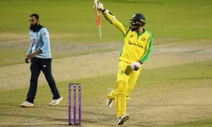 Mitchell Starc of Australia celebrates hitting the winning runs and victory as Adil Rashid of England looks dejected.