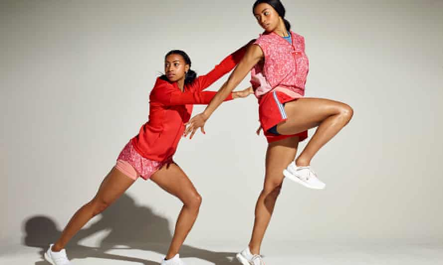 Shannon and Cheriece Hylton in athletics kit, one behind the other pushing her forward, both taking a long stride