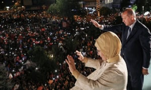 Turkish resident Recep Tayyip Erdoğan and his wife Emine Erdoğan celebrate Sunday's election victory in Ankara.