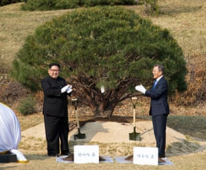 President Moon Jae-In and North Korean leader Kim Jong-Un plant a commemorative tree at the Joint Security Area