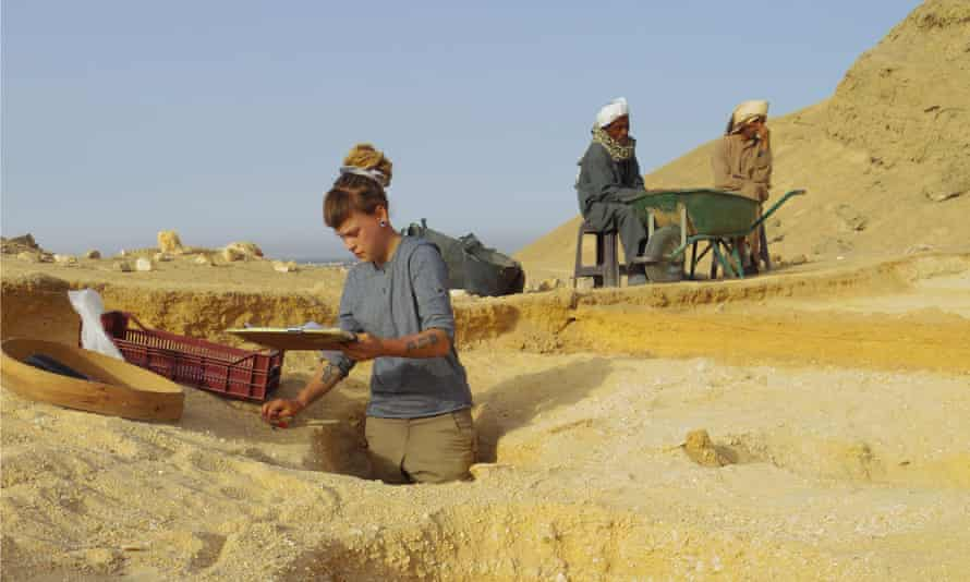 Excavating waist-deep graves at the North Tombs Cemetery. An archaeologist planning an excavated grave.