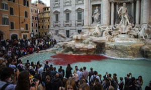 The blood-red dye was poured into the Trevi by public-artist Graziano Cecchini.