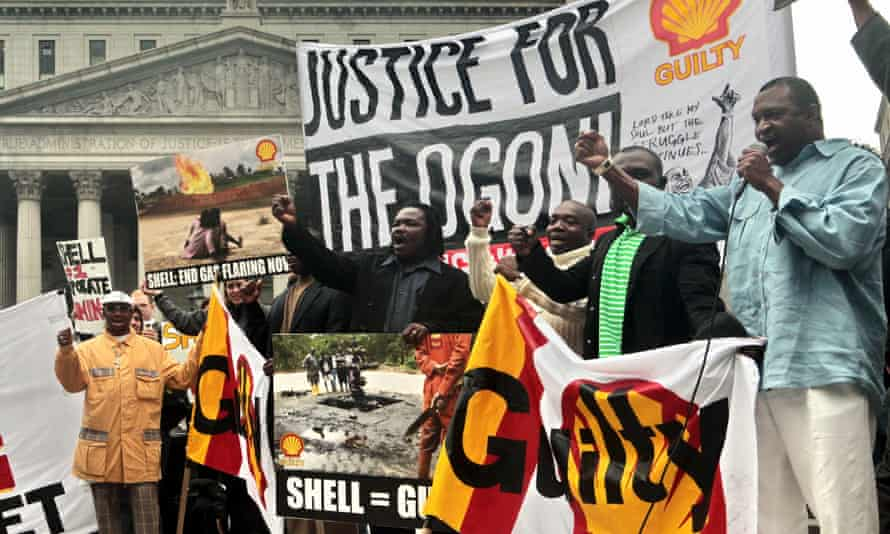 Members of Nigeria's Ogoni protest against Shell