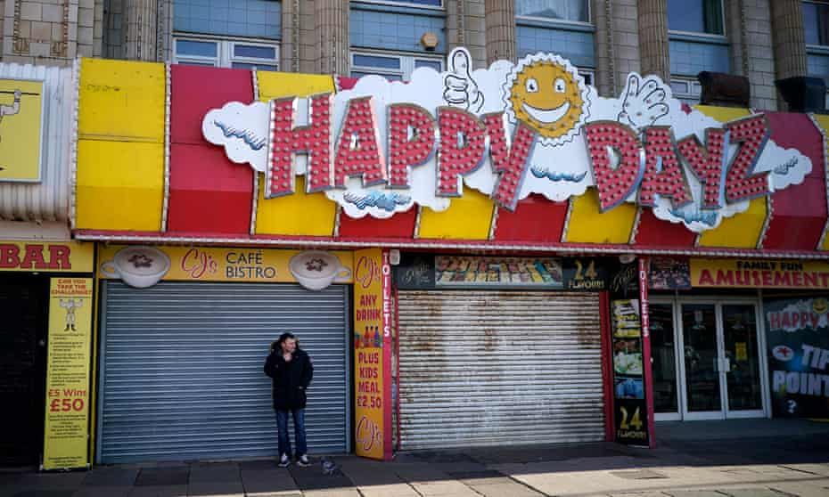 A man stands outside a closed cafe in Blackpool