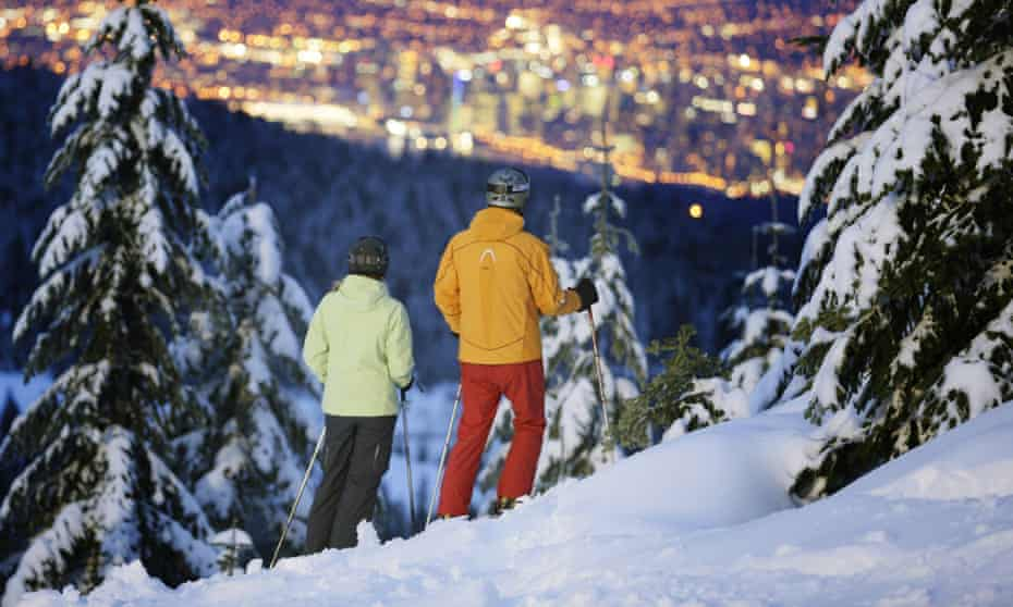 Skiers at Cypress mountain enjoy the view over Vancouver.