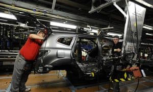 Nissan technicians work on a Qashqai car on the production line at the company's plant in Sunderland.