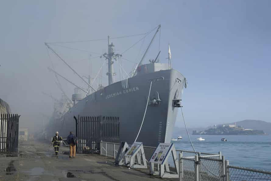 Fire officials stand in front of the SS Jeremiah O'Brien.