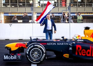 Dutch Grand Prix sporting director Jan Lammers waves the Dutch flag as the starting signal for the first official lap of Red Bull's Dutch F1 driver Max Verstappen at the renewed Zandvoort circuit where the Dutch Grand Prix will return in May for the first time since 1985.