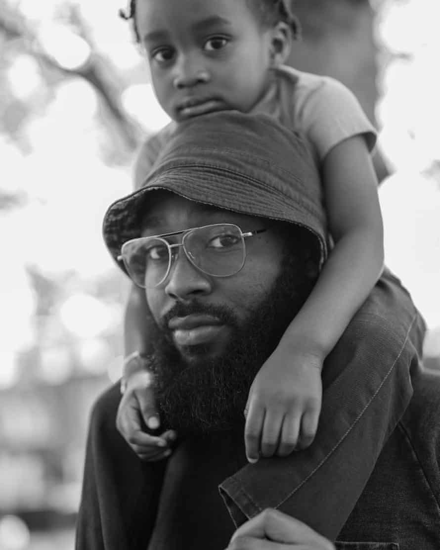 Kyron and his son Malakai in a park