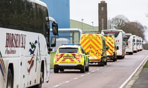 The convoy transporting British nationals who had arrived from Wuhan to the Wirral on Friday