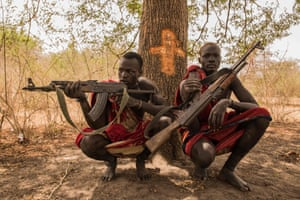 Cattle keepers Achiek Butich and Makal Maker pose with their weapons