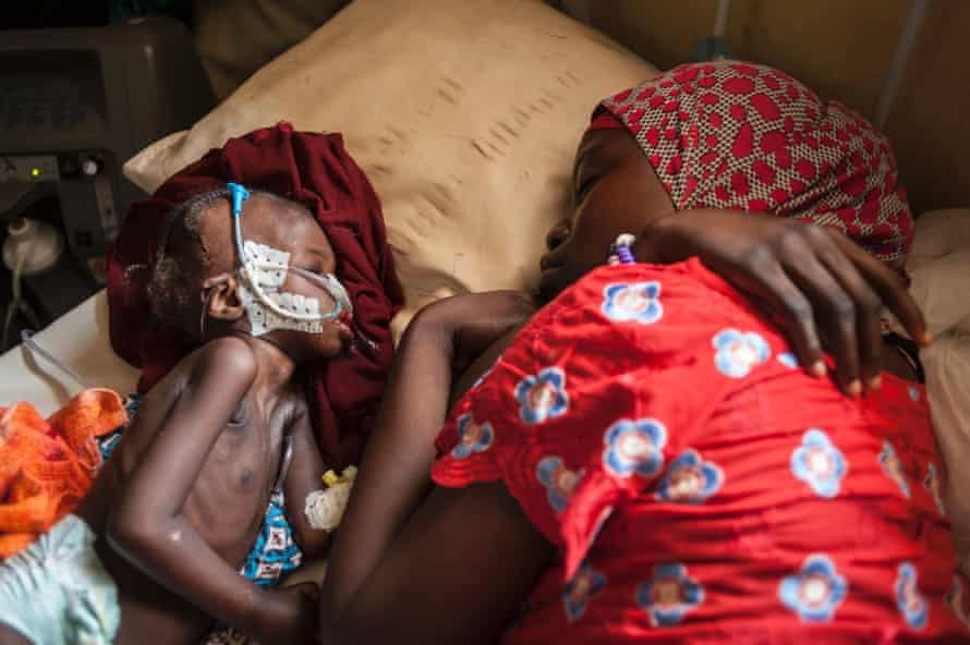 A woman and a young child suffering from severe malnutrition sleep at the In-Patient Therapeutic Feeding Centre in the Gwangwe district of Maiduguri, Borno State, September 2016.